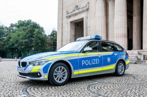 Polizeiauto blau gelb